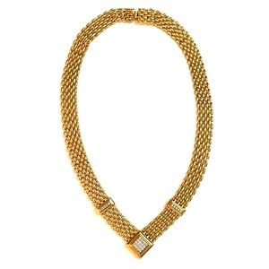 Gold tone necklace with rhinestone accents